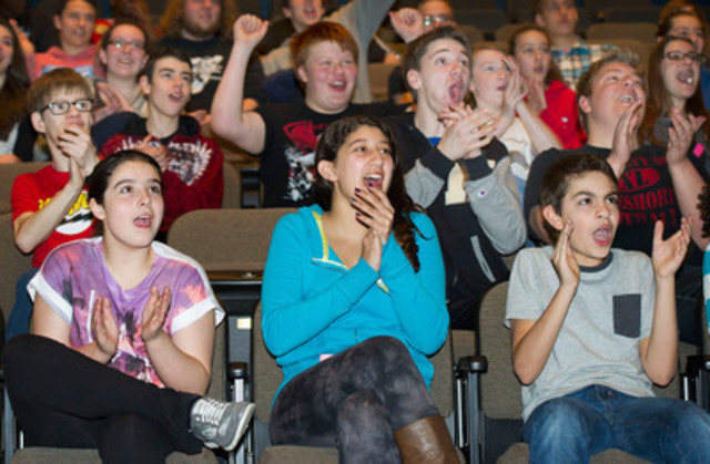 John Rennie High School students react after learning that their school is 1 of 10 Staples Canada Recycle for Education Computer Lab Contest winners. The school won $25,000 from Staples to upgrade their computer lab. (CNW Group/Staples Canada Inc.)