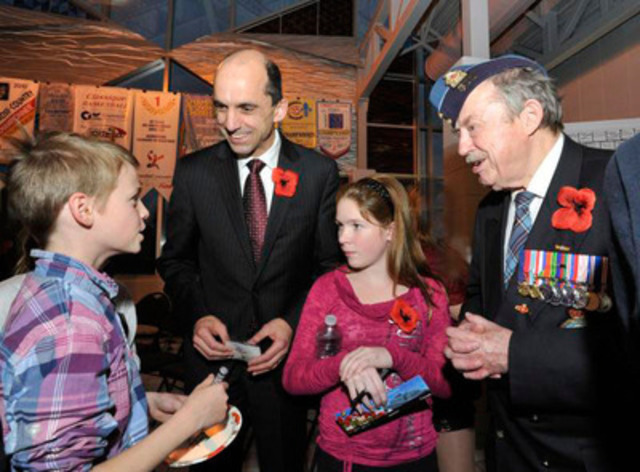 Minister of Veterans Affairs Steven Blaney visited L'Envol High School in Saint-Nicolas and participated in a commemorative ceremony organized by students. He is joined by Royal Canadian Air Force Veteran Jean Cauchy (R) (CNW Group/Veterans Affairs Canada)