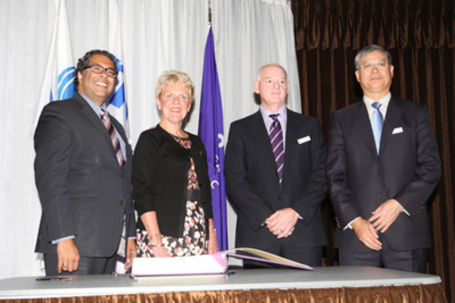 Mayor Naheed Nenshi, Ellen Humphrey, Nexen CEO Kevin Reinhart, and Mr. Li Fanrong, CEO of CNOOC Ltd. signed a special log book to record major donations to Add In, the Campaign for Calgary's Library. The CNOOC Limited Nexen contribution of $1.5 million is the largest corporate gift in the Library's 101-year history. (CNW Group/Calgary Public Library Foundation)