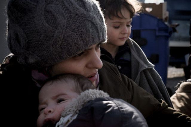 On November 28, Nour Majati cradles her one-month-old son, Youssef, in the former Yugoslav Republic of Macedonia, on the Serbian border. Mrs. Majati, her husband and their four children fled Aleppo, Syria, following bombing attacks on their home. She was pregnant with Youssef at the time and gave birth via Caesarean section just before they fled Syria. Her surgical wound opened during the long, arduous journey—overland in Turkey, by sea to Greece, and overland again, walking for days, towards Central Europe. Photo credit: © UNICEF/UN02839/Gilbertson VII (CNW Group/UNICEF Canada)