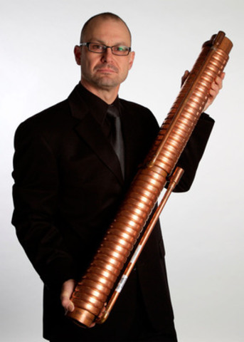 Watercycles Energy Recovery Inc. President Andre Cayer with one of his drain water heat recovery units. (CNW Group/Canadian Copper & Brass Development Association)