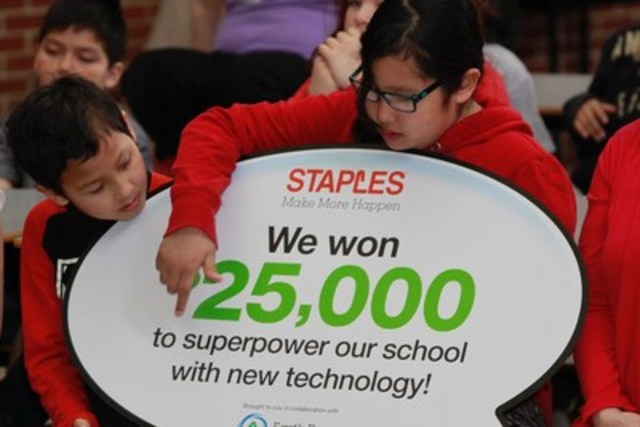 Grade 4 students, Dominique Ausustine (left) and Zoey Milliea (right), from Elsipogtog First Nation School, cannot believe they've won $25,000 worth of technology. Their school is being recognized for their eco efforts through the 2016 Staples Canada Superpower your School Contest. (CNW Group/Staples Canada Inc.)