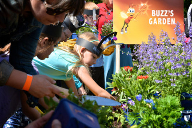 Families join Honey Nut Cheerios in planting a pollinator-friendly garden at Black Creek Pioneer Village. The event was in celebration of the #BringBackTheBees campaign which saw Honey Nut Cheerios give away more than 115 millions wildflower seeds to Canadians across the country. (Photo Credit: Shan Qiao) (CNW Group/General Mills Canada)