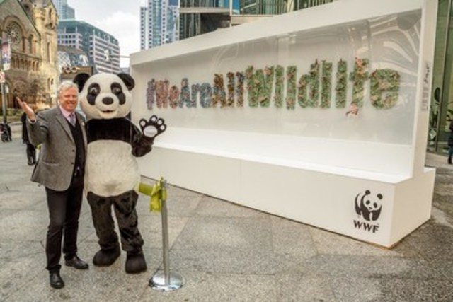 Today, David Miller, President and CEO of WWF-Canada, unveiled a one-of-a-kind 'origami wilderness' art installation at 200 King Street West, a space donated by WWF Living Planet at Work Supporter Bentall Kennedy (Canada) LP. The 400 pieces of origami plants, animals, and flowers represent the organization's new initiative, We Are All Wildlife, and is a reminder that nature and the economy must work together to sustain healthy communities. The wall will be up from November 24 to December 1. (CNW Group/WWF-Canada)
