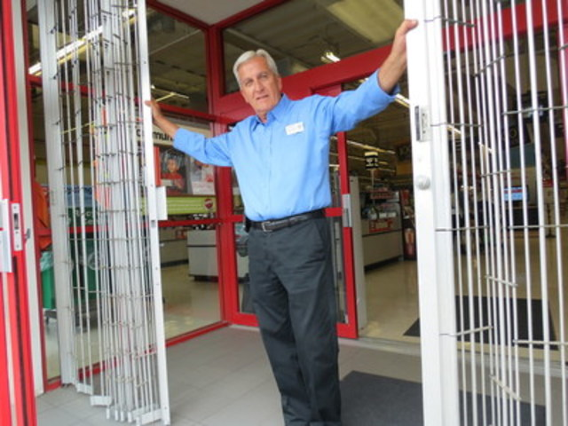 Howard Fitzpatrick, General Manager, opens the doors to the 945 Eglinton Avenue East Staples location as he prepares to help parents, teachers and students complete their back-to-school shopping. (CNW Group/Staples Canada Inc.)