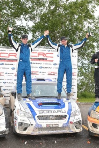 Alan Ockwell, Subaru Rally Team Canada (SRTC) co-driver, and Antoine L'Estage, SRTC driver, celebrate the Rallye Baie Des Chaleurs victory on the podium. (c) Copyright 2015 Rocket Rally Racing - by Phil Ericksen. (CNW Group/Subaru Canada Inc.)