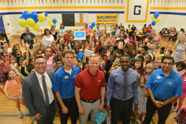 Best Buy Canada together with actor and comedian Gerry Dee surprise 'Dee-light' Guildwood Junior Public School with all brand new technology, as part of their ongoing School Tech Grants program. This is one example of Best Buy Canada's commitment to supporting youth and education. Pictured with Guildwood students, from left to right are: Elliott Chun, Communications Manager, Best Buy; Ian Evans, Operations Manager, Best Buy Scarborough; Gerry Dee, Actor and Comedian; Eckleton Richards, Principal, Guildwood Junior Public School; Sanjeev Chandna, General Manager, Best Buy Scarborough (Photographer: Shan Qiao) (CNW Group/Best Buy Canada)