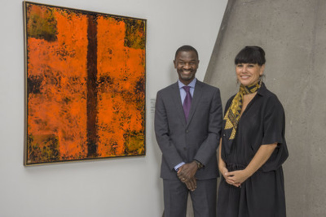 Mr. Chirfi Guindo, President and Managing Director of Merck Canada Inc. (left) and Ms. Nathalie Bondil, Director and Chief Curator of the Montreal Museum of Fine Arts (right) with the painting by renowned artist Jean McEwen donated by Merck Canada to the museum's permanent collection. The painting is an original by the late painter, who is considered one of the giants of contemporary art in Quebec and Canada. A pharmacist by training, McEwen always had a keen interest in painting and, in 1951, only one year after graduating from the Université de Montréal, decided to pursue a full-time art career and moved to Paris, France. The abstract work of art by the famed artist was previously part of Merck's corporate art collection and, until recently, was housed in the company's Canadian headquarters. (CNW Group/Merck Canada Inc.)