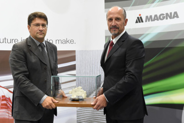 Riccardo Berti (left), Director of Product Management & Business Development at Magna Closures Europe, and Franco Ottino, Director of Engineering at Magna Closures Europe, at the 50 million latches celebration held at Magna's Guasticce, Italy, manufacturing facility. (CNW Group/Magna International Inc.)