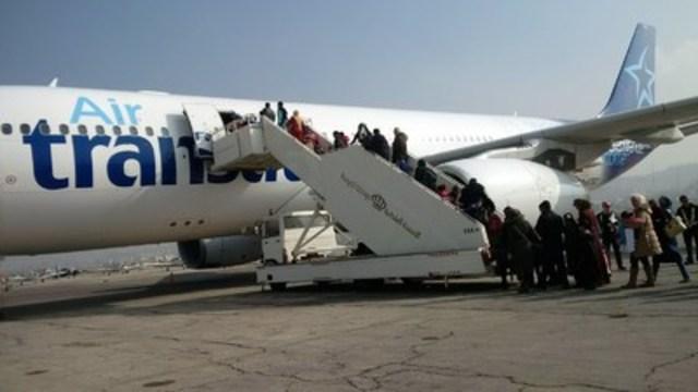 20 décembre 2015 - 207 réfugiés syriens ont quitté Amman ce matin à bord d'un Airbus A330 d'Air Transat, à destination de Toronto. Air Transat est la première compagnie aérienne canadienne à effectuer un vol dans le cadre de cette opération humanitaire. (Groupe CNW/Transat A.T. inc.)
