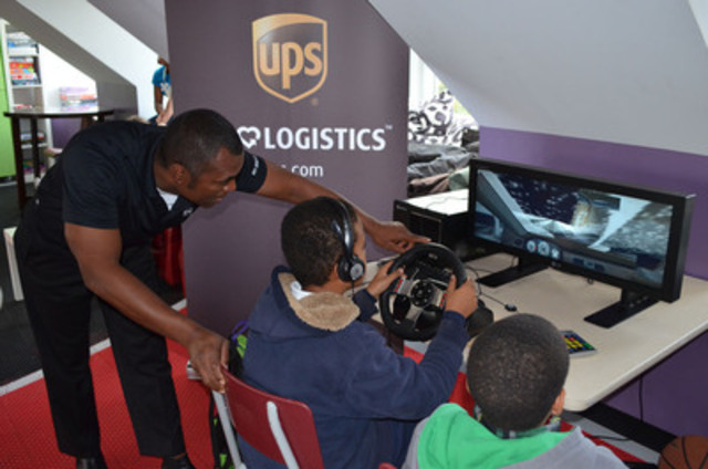UPS Road Code instructor Rohan Stephens guides the way with youth from the Toronto Kiwanis Boys and Girls Club on a driving simulator. On Tuesday, The UPS Foundation presented a $100,000 grant to the Boys and Girls Clubs of Canada to help sustain the UPS Road Code program. (CNW Group/UPS Canada Ltd.)