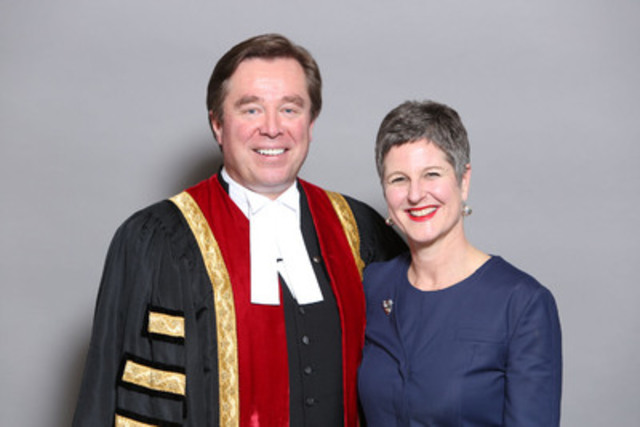 Law Society Treasurer Thomas G. Conway congratulates Toronto lawyer Susan E. Opler on receiving the 2014 Laura Legge Award at the Law Society's annual awards ceremony in Toronto on May 21. (CNW Group/The Law Society of Upper Canada)