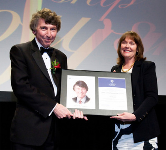 John MacNaughton (left) receives his 2011 ICD Fellowship Award from presenter Sarah Raiss. (CNW Group/Institute of Corporate Directors (ICD))