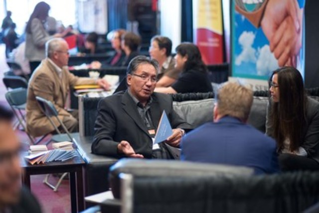 Aboriginal Business Match (ABM) delegates discuss business opportunities on the tradeshow floor. ABM provides a supportive and confidential setting for pre-selected appointments like these to take place all across Canada. (CNW Group/Aboriginal Business Match)