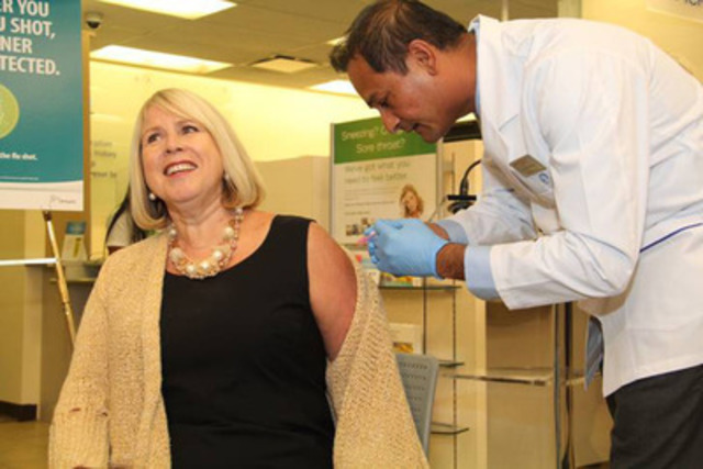 Ontario Health Minister, Deb Matthews, receives her flu shot by Shoppers Drug Mart pharmacist, Hitesh Pandya, to launch the annual flu immunization campaign. (CNW Group/Shoppers Drug Mart Corporation)
