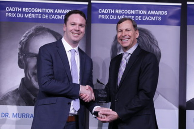 Dr. Nick Bansback receives the Maurice McGregor Award at the 2016 CADTH Symposium from Dr. Brian O'Rourke, President and CEO, CADTH. (CNW Group/Canadian Agency for Drugs and Technologies in Health (CADTH))