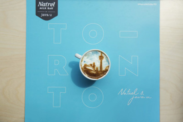 Local Brew: The ''Toronto Latte'' is now available at the Natrel Milk Bar by java u, which officially opened today at 1092 Queen St. West. Toronto''s iconic skyline was painted by renowned coffee artist Michael Breach at the grand opening of the new cafe. (Photo credit: Max Kopanygin) (CNW Group/Natrel)