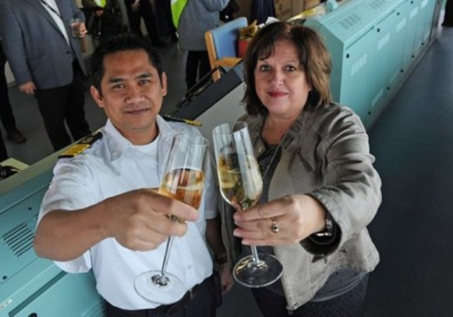 Ms. Sylvie Vachon, President and Chief Executive Officer of the Montreal Port Authority (MPA), with Captain Jun Eric Aljo Dalipe of the Vigorous, first ocean-going vessel to reach the Port of Montreal in 2016. (CNW Group/PORT OF MONTREAL)
