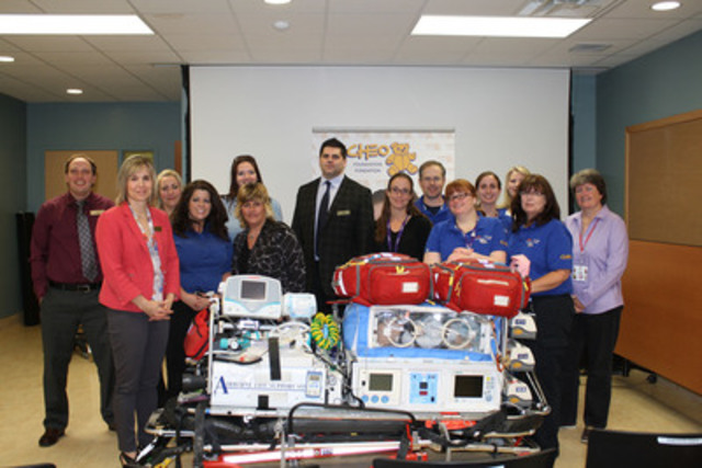 LCBO representatives celebrate the generosity of customers and staff who raised over $312,000 for CHEO Foundation as part of the 2013 Giving Back In Our Community campaign. These funds will purchase a new isolette (pictured) to transport premature babies to the hospital. (CNW Group/LCBO)