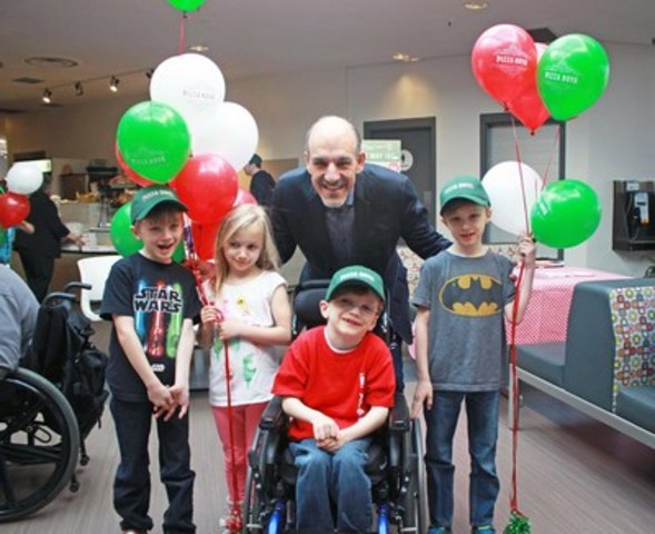 Pizza Nova President Domenic Primucci poses with Variety Village members on Pizza Nova's 17th annual That's Amore Pizza for Kids day. (CNW Group/Pizza Nova)