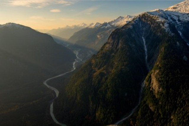 British Columbia's rivers are conveyor belts from the mountains to the ocean. The ASJ team used inflatable packrafts to paddle downriver and complete their route across BC's coast range (as seen in Crossing Home: A Skier's Journey). (CNW Group/Arc'teryx)