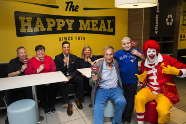 McHappy Day celebrations took place across Canada Wednesday. In Toronto, McDonald's Canada founder George Cohon joined Regional VP Victor Rocca, RMHC Canada's Cathy Loblaw, the Mitchell family (guests at Ronald McDonald House Toronto), and Ronald McDonald to help raise money for thousands of families. (CNW Group/McDonald's Canada)