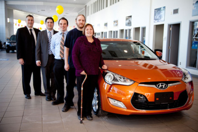 (from L to R) Ryan Dyck, Guy Bordian and Daryl Brown from Winnipeg Hyundai present Hyundai Musical Shorts contest winner Randy Granger and his mother Jeanette Granger with the grand prize of a 2012 Hyundai Veloster 3-door coupe. Randy Granger decided to enter the contest to win a car for his mother and gave the car to her at the dealership. (CNW Group/Hyundai Auto Canada Corp.)
