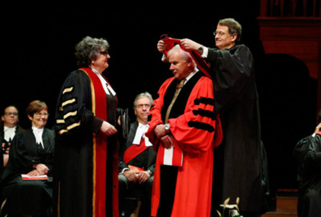 The Hon. Peter Milliken, PC, OC (centre) is conferred an honorary LLD by Law Society of Upper Canada Treasurer Janet Minor (left) and hooded by Bencher Chris Bredt. Milliken was honoured for his remarkable contribution to Canadian politics while Speaker of the House of Commons. (CNW Group/The Law Society of Upper Canada)
