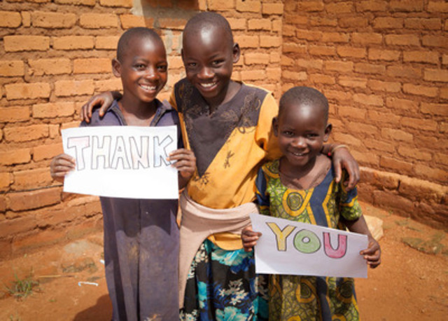 "Sponsored siblings (L-R): Miyoba (age 8); Mutinta (age 9) and Lwiito (age 3), of Zambia, take a moment to say ""thank you."" (CNW Group/World Vision Canada)"