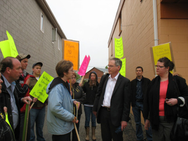 A school bus operator from Arthur, ON, whose family business of 60 years was wiped out in a government pilot project, confronts her MPP, Jim Wilkinson, for failing to represent the interests of his rural constituents. Jim Wilkinson was defeated in the October 2011 election. (CNW Group/Independent School Bus Operators Association)