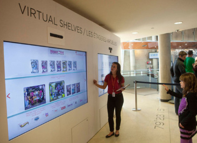 An eager shopper interacts with Mattel's virtual toy shelves at the Digital Shop 'n Play at the CN Tower. (CNW Group/Mattel Canada, Inc.)