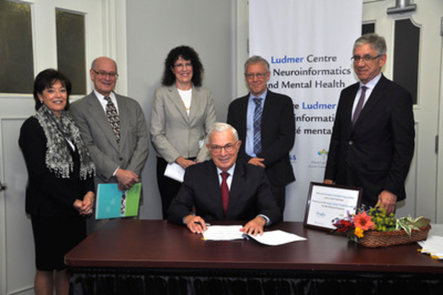 Announcement of the creation of the Ludmer Centre for neuroinformatics and mental health. From left to right : Mrs. Ludmer, Mr. Bick, Ms. McVey, Dr.Meaney, Dr. Stern. Sitting: Mr. Ludmer (CNW Group/Douglas Mental Health University Institute)