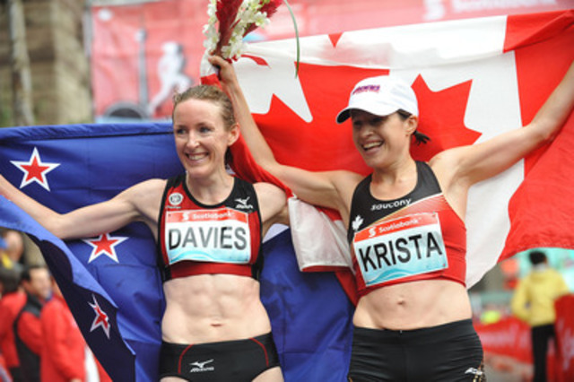 New Zealand's Mary Davies (left) takes the top spot at the Scotiabank Toronto Waterfront Marathon with a time of 2:28:56. Krista Duchene of Brantford, Ontario, was the first Canadian woman to finish the race with the time of 2:32:15. Photo credit: Todd Duncan. (CNW Group/Scotiabank - Sponsorships & Donations)