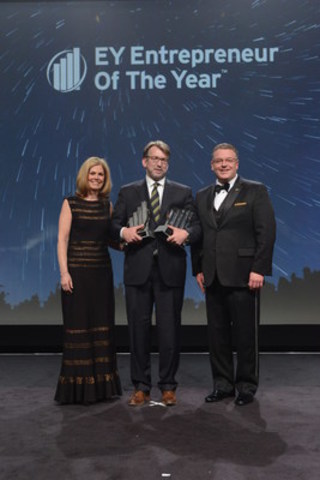Patrick Priestner, Executive Chairman of AutoCanada Inc. was named EY Entrepreneur Of The Year Prairies 2015 at an awards gala in Calgary last night. Tom Orysiuk, CEO and President of AutoCanada Inc. (pictured centre), accepted the award on behalf of Patrick Priestner. Colleen McMorrow and Rob Jolley, both of EY, presented the award. (CNW Group/EY (Ernst & Young))
