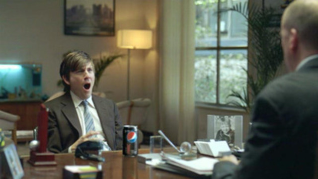 "In this PEPSI MAX Super Bowl commercial entitled ""Interview"", a young 20-something behaves outrageously during a job interview so that his buddy is a shoo-in for the job. (CNW Group/PEPSICO CANADA)"