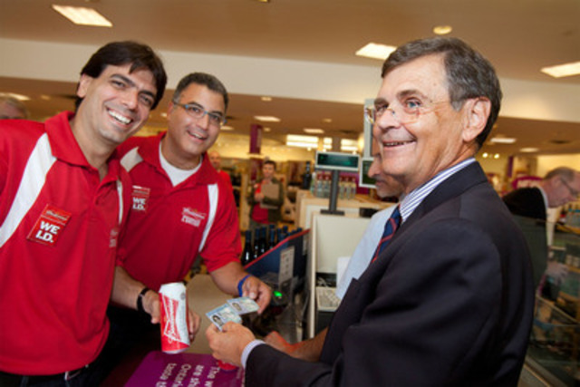 LCBO President and CEO Bob Peter (right) checks the I.D. of Labatt President Bary Benun (left) and Vice President Charlie Angelakos (centre) during Labatt's annual Be(er) Responsible Day. Labatt employees visited LCBO outlets across Toronto and London to raise awareness of the importance of responsible use and moderation. (CNW Group/Labatt Breweries of Canada)
