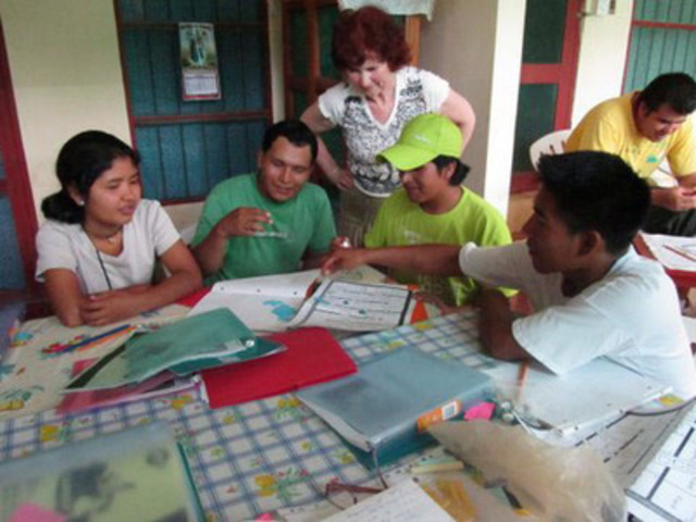 Rita Andersson teaches English to a group of tour guides in Rurrenabaque, Bolivia. Andersson is part of a team of teachers who have volunteered on the three month program. The project thus far is a resounding success with enthusiastic students wanting to see its return next year. (CNW Group/Advance Consulting for Education Inc.)