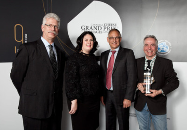 Dairy Farmers of Canada Vice-President Reint-Jan Dykstra, Executive Director Caroline Émond, and President Wally Smith, with Jean Morin from the Fromagerie du Presbytère (QC), whose Laliberté cheese was named Grand Champion of the 2015 Canadian Cheese Grand Prix in Toronto on April 22 (CNW Group/Dairy Farmers of Canada (DFC))