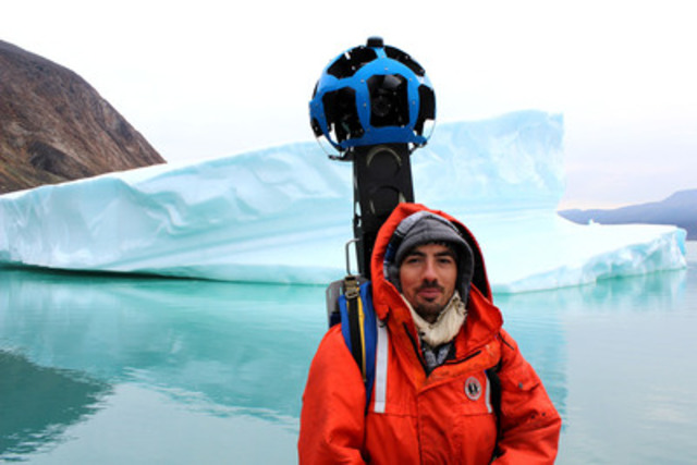 A Google team member using the Google Trekker to capture the North Pangnirtung Fjord by boat, in Auyuittuq National Park in Nunavut.  (CNW Group/Parks Canada)