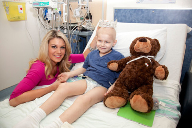 Miss America 2013, Mallory Hagan donates $5,000 to Montreal Children's Hospital Foundation on behalf of her clothing provider, Canadian fashion house Joseph Ribkoff while visiting with Liam Armstrong Tuesday. (CNW Group/Joseph Ribkoff)
