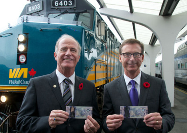 Marc Laliberté and Tiff Macklem are shown standing in front of the Canadian train during an official ceremony to issue the new $10 polymer bank note into circulation, at the Pacific Central Station in Vancouver, British Columbia. (CNW Group/Bank of Canada)