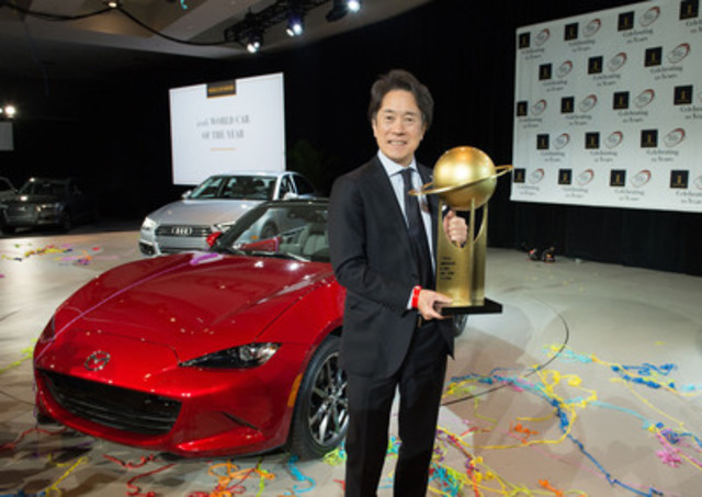 Masahiro Moro, President and CEO, Mazda North American Operations, and Managing Executive Officer, Mazda Motor Corporation, accepting the award for 2016 World Car of the Year for the Mazda MX-5. (CNW Group/Mazda Canada Inc.)