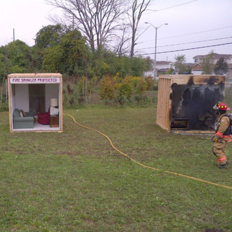 "The Co-operators and Guelph Emergency Services ""side-by-side burn"" sprinkler demonstration. (CNW Group/The Co-operators)"
