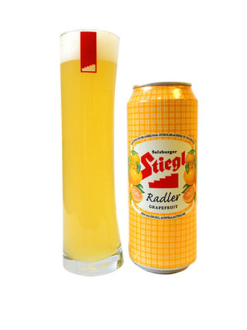 Just in time for summer, Stiegl Grapefruit Radler, a refreshing fruit beer made with pure grapefruit juice and all natural ingredients, is now available in 500 mL cans across Canada. (CNW Group/McClelland Premium Imports)