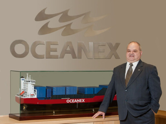 Captain Sid Hynes, Executive Chairman of Oceanex Inc., at the company's corporate office in St. John's, Newfoundland. The model is of the Oceanex Avalon, the newest vessel in the Oceanex fleet. (CNW Group/OCEANEX INC.)