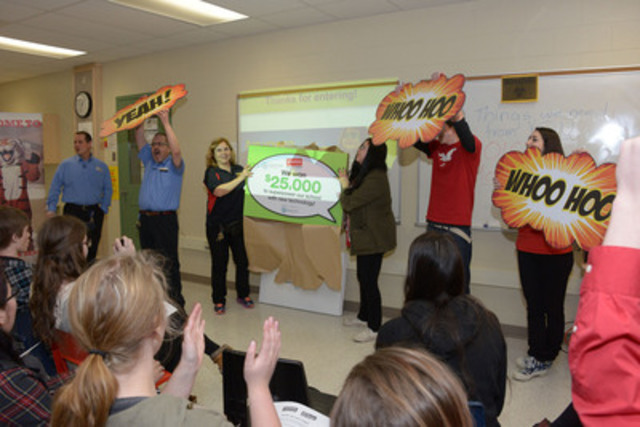 Staff and students of Saunders Secondary School in London celebrate having won the Staples Superpower your School Contest. As one of ten winners, the school will get new technology worth $25,000. (The Canadian Press Images) (CNW Group/Staples Canada Inc.)