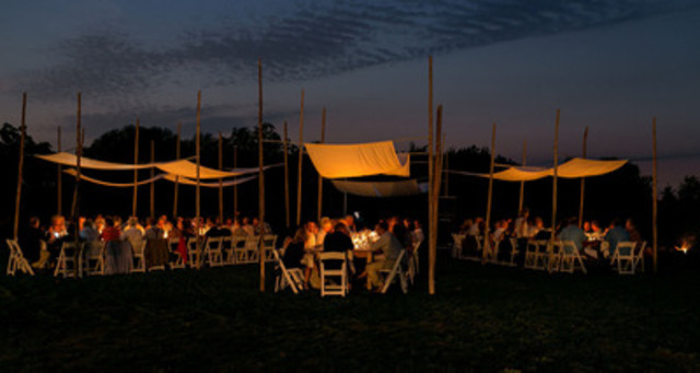 Lucky diners sip and savour the tastes under the stars at Ravine Vineyard Estate Winery, a participant in this year's long-table dinner on August 20.  (CNW Group/Wine Council of Ontario)