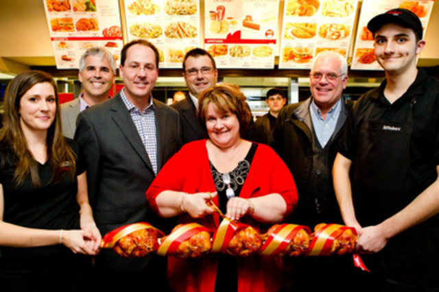 From left to right: Jessé Campeau, Assistant Director, Customer Experience and Opening, Daniel Cousineau, President, Les Rôtisserie St-Hubert Canada Ltd, Richard Scofield, Vice-president, Restaurants, Michelle Bauder, General Manager of the new St-Hubert Express Kingston, and Rick Downed, City Council, Cataraqui District with two employees of the new St-Hubert Express Kingston. (CNW Group/Les Rôtisseries St-Hubert)