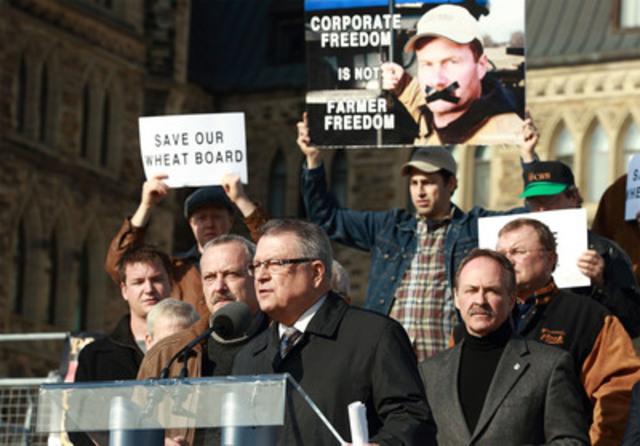 Deputy Liberal leader, Ralph Goodale (M), Chair of the Canadian Wheat Board, Allen Oberg (L), and NDP agriculture critic, MP Pat Martin (R), speak out on Parliament Hill in support of the Canadian Wheat Board. Photo by Jana Chytilova for CNW. Narrative Advocacy PR for the Canadian Wheat Board (CNW Group/CANADIAN WHEAT BOARD)