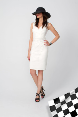 Le Château Revs Up Grand Prix Fashion By Dressing This Year's Grid Girls in Sophisticated White Fitted Dresses and Hats. (CNW Group/LE CHATEAU INC.)